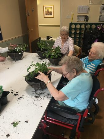 Millfield residents take orders for hanging baskets